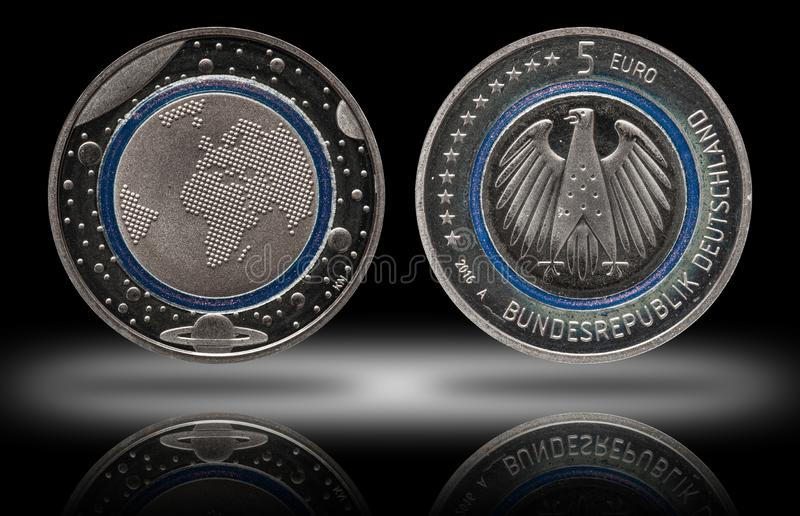 Germany five euro coin with planets and blue polymer ring. Proof stock photo