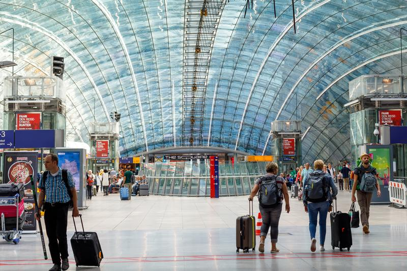 Germany, Frankfurt, August 16, 2019: Commuters people walking inside the large hall of Frankfurt airport with The Squaire business royalty free stock images
