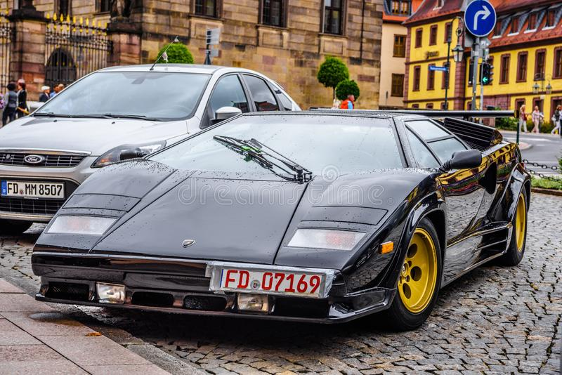 GERMANY, FULDA - JUL 2019: black LAMBORGHINI COUNTACH is a rear mid-engine, rear-wheel-drive sports car produced by the Italian. Automobile manufacturer royalty free stock images