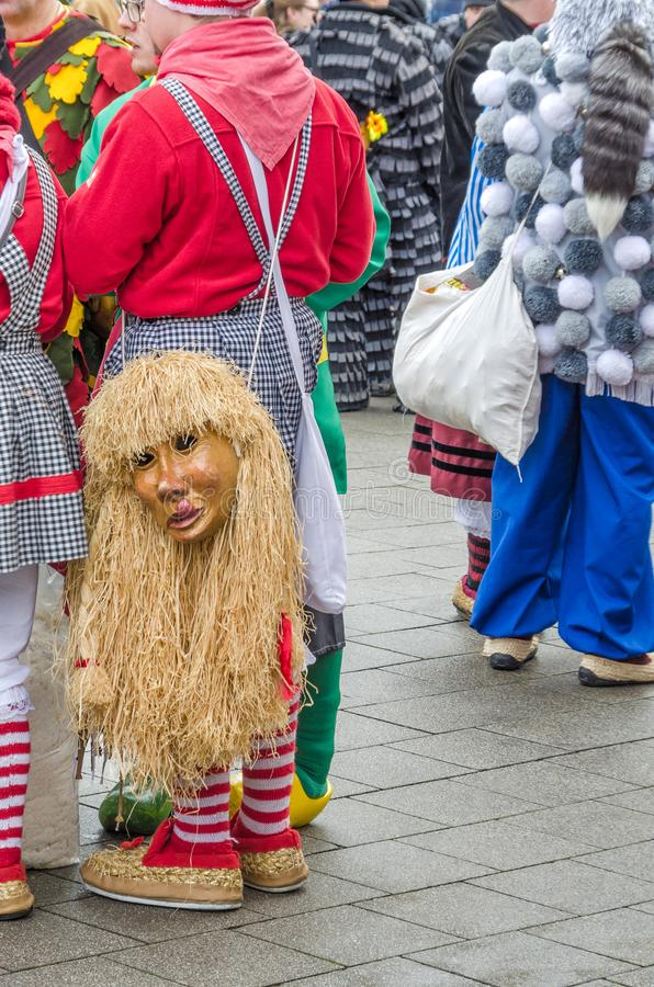 Germany, Lahr - JANUARY 17: Participants in costumes perform a s. Treet procession Carneval Fasnacht January 17, 2016 in the city of Lahr, Germany. Traditionally stock photos