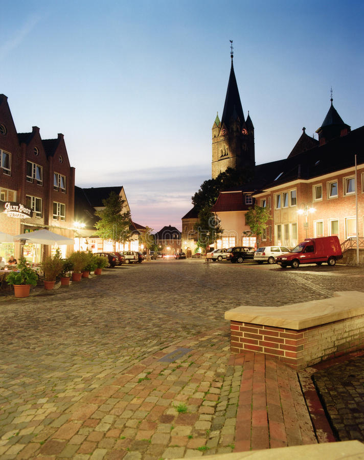 Germany,Lower Saxony,Ankum,St. Nikolaus Cathedral. In the early evening with blue sky stock photo