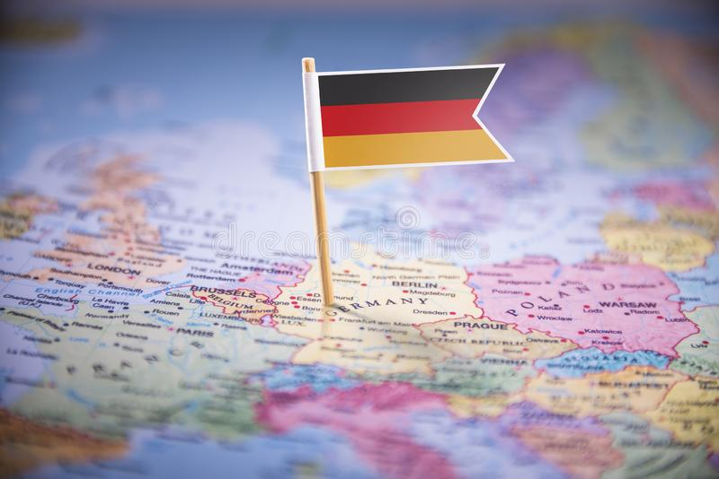 Germany marked with a flag on the map.  stock images