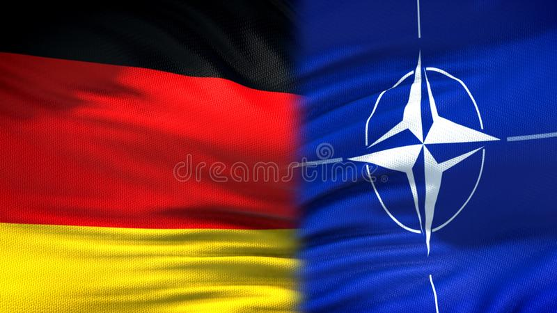Germany and NATO flags background, diplomatic and economic relations, security. Stock photo royalty free stock images