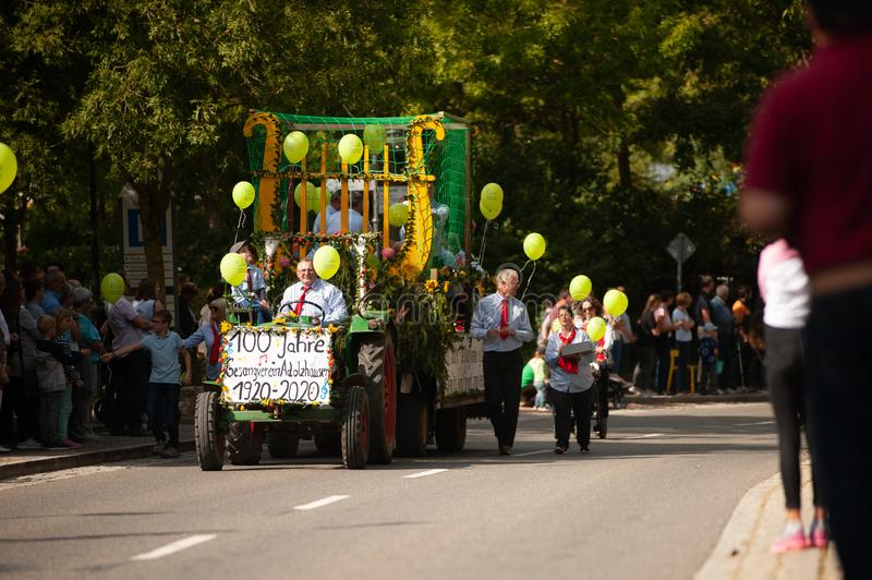 Germany, Niederstetten, Baden Wurttemberg. September 2019. Traditional Parade as a part of autumnal Harvest Fest, in German:. Herbstfest. Tractor of Singing stock images