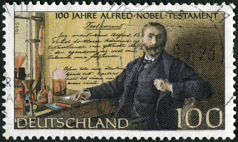 GERMANY - 1995: shows Alfred Bernhard Nobel 1833-1896, in laboratory, Nobel Prize Fund Established. GERMANY - CIRCA 1995: A stamp printed in Germany shows Alfred royalty free stock photography