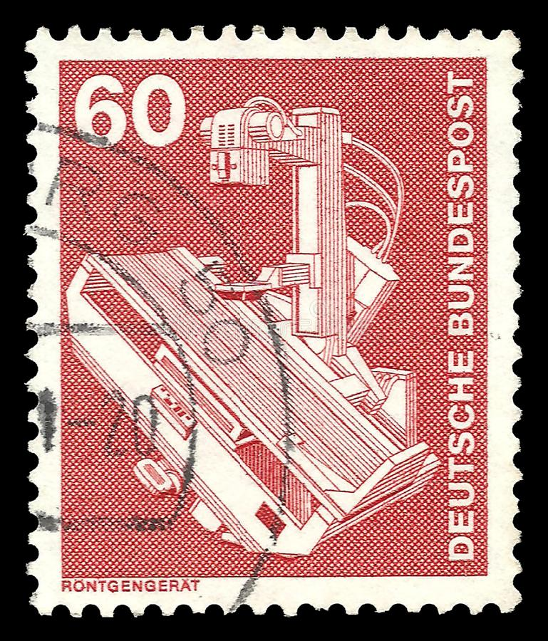 X-ray device. Germany - stamp 1978: Color edition on Industry and Technology, shows X-ray device stock images
