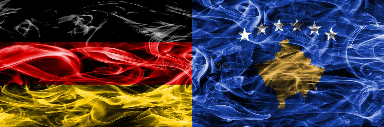 Germany vs Kosovo smoke flags placed side by side. German and Ko stock images