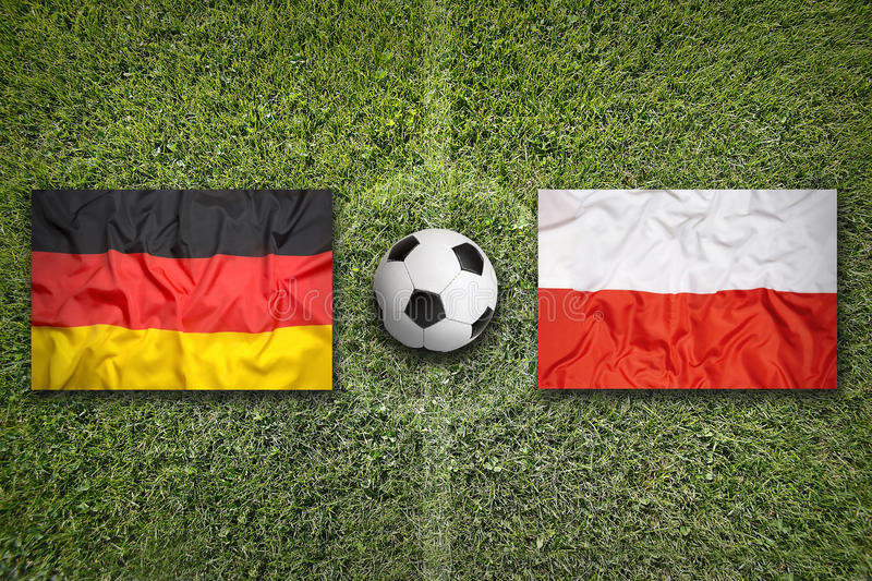 Germany vs. Poland flags on soccer field royalty free stock photography