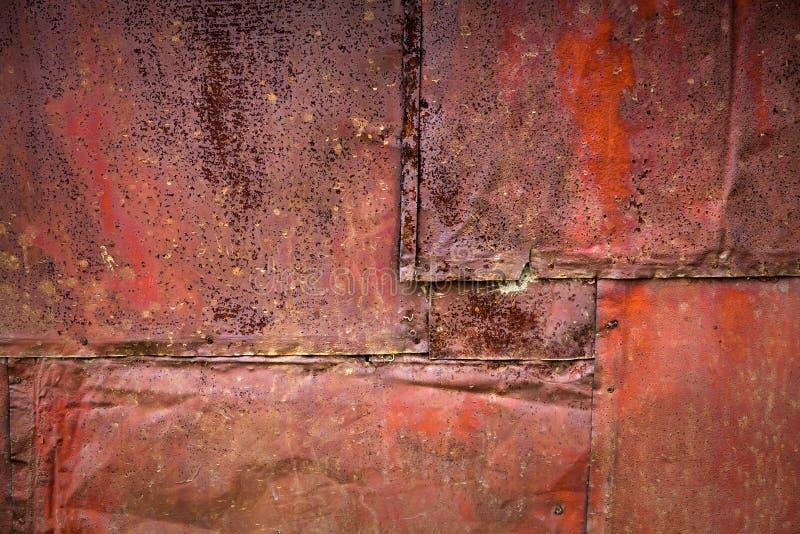 Geroeste metaalmuur gedetailleerde textuur als achtergrond stock afbeeldingen