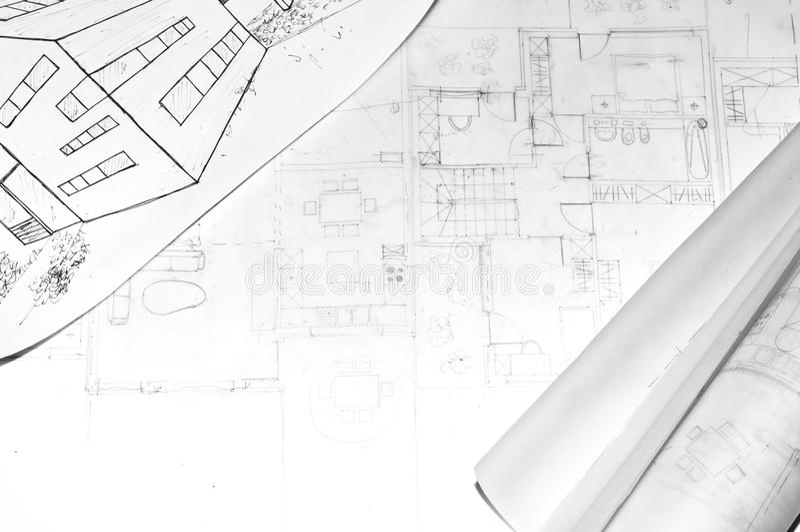 Gerollte Architektur plant auf einem Zeichnungsod-Haus stockfotografie