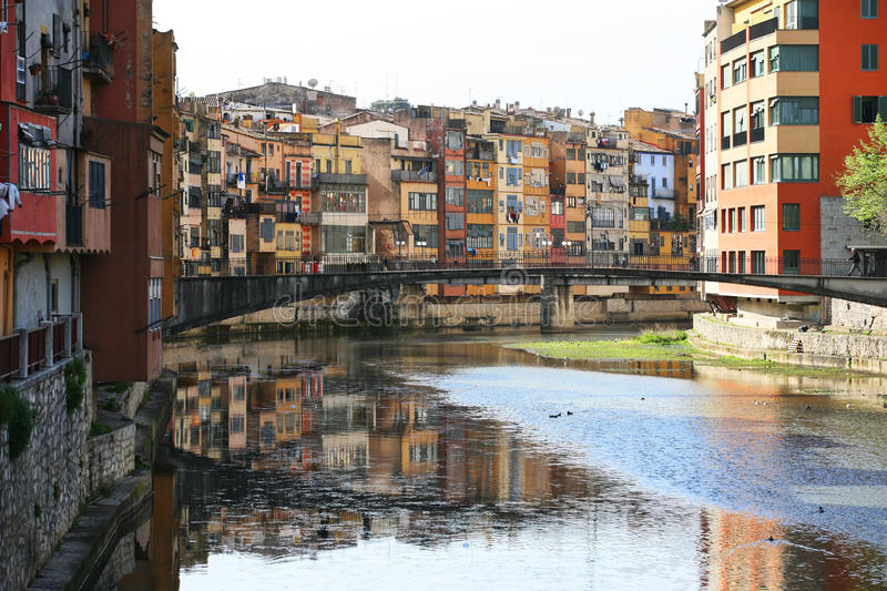 Gerona. Typical view of girona in catalonia the river onyar and the different painted buildings in front of it royalty free stock photo