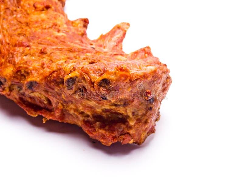 Gerookt varkensvlees op witte achtergrond stock foto's