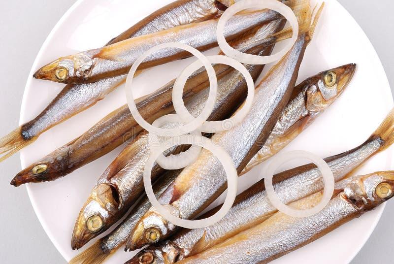 Gerookte vissen op een plaat royalty-vrije stock foto