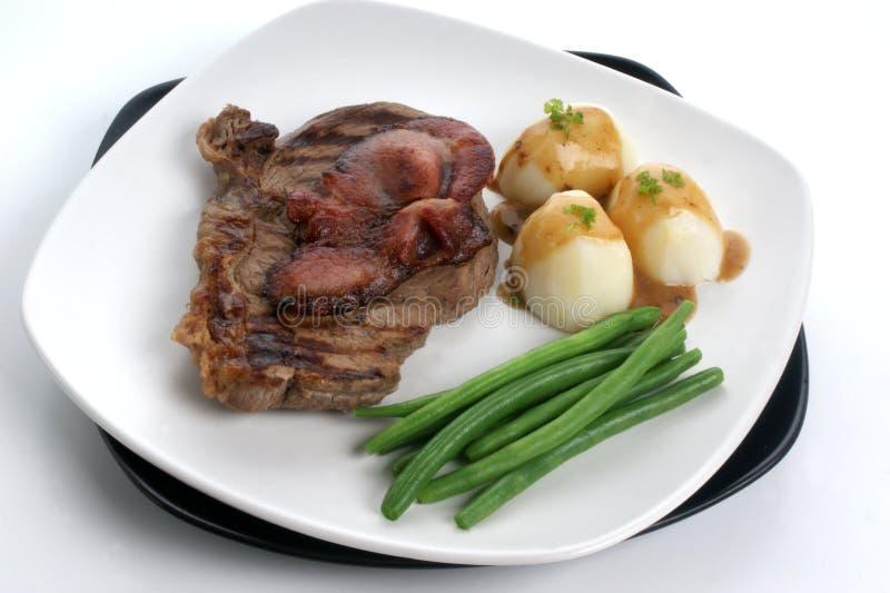 Geroosterd achterdeellapje vlees en bacon met aardappel royalty-vrije stock fotografie