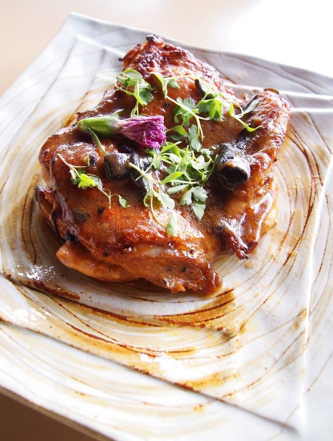 Geroosterd kippenlapje vlees stock foto