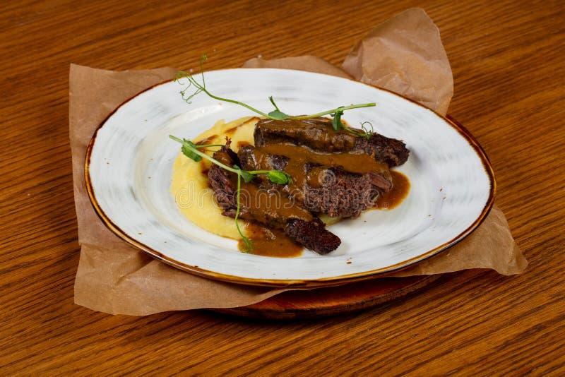 Geroosterd rundvlees met jus stock afbeelding