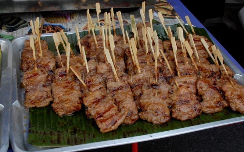 Geroosterd varkensvlees in markt, Gemarineerd geroosterd gezond varkensvlees stock afbeelding