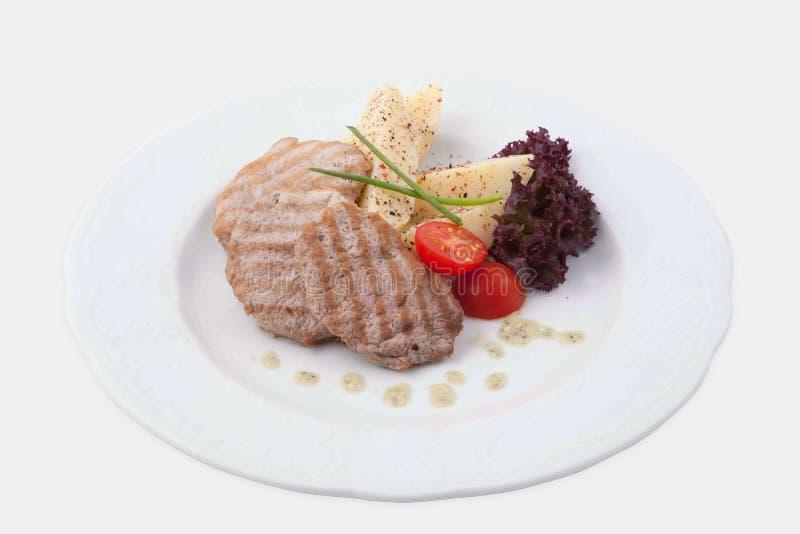 Geroosterd varkensvlees met aardappel stock afbeeldingen