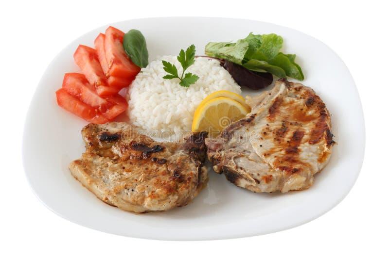 Geroosterd varkensvlees met gekookte rijst stock afbeelding