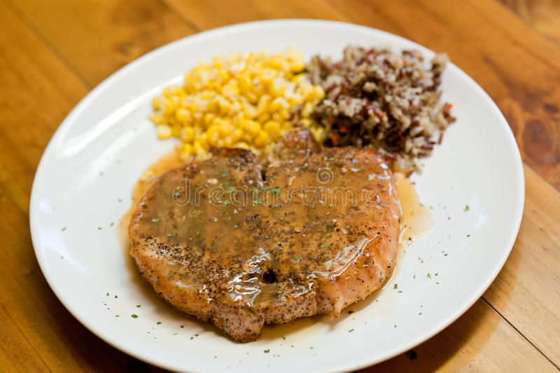Geroosterd varkensvlees met rijst en aardappel royalty-vrije stock fotografie
