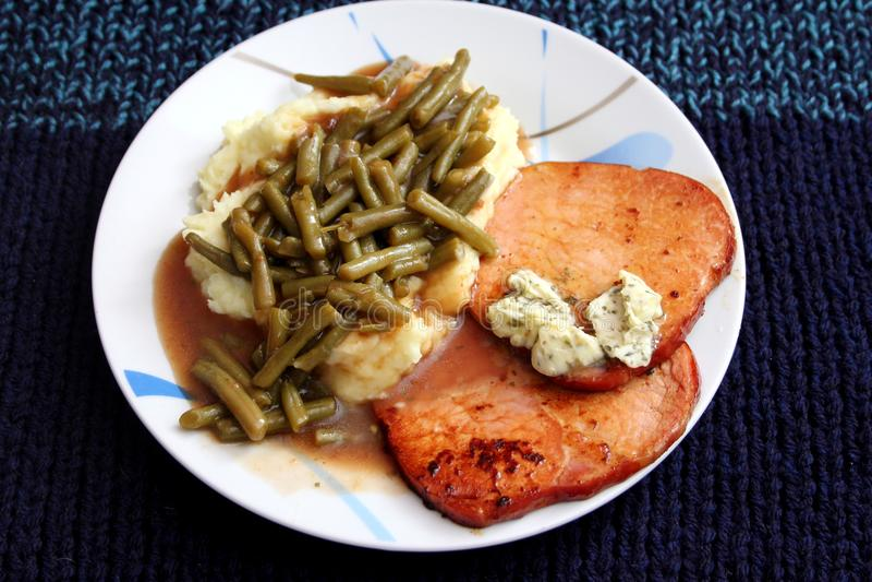 Geroosterd varkensvleesvlees met boter stock foto