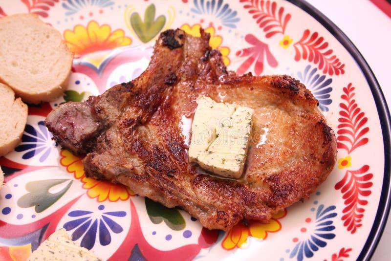 Geroosterd varkensvleesvlees met knoflookboter royalty-vrije stock afbeeldingen
