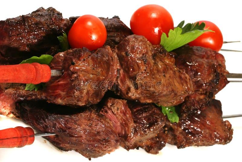 Geroosterd vlees op vleespen met tomaten royalty-vrije stock afbeeldingen