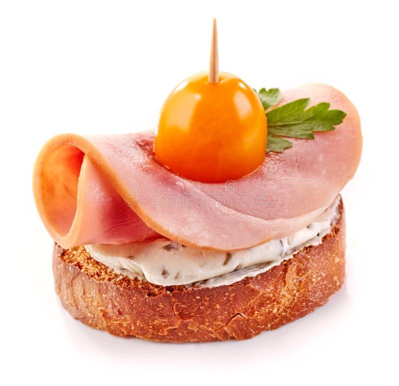 Geroosterde broodplak met ham en tomaat royalty-vrije stock afbeeldingen