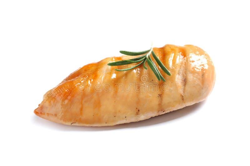 Geroosterde die kippenborst met rozemarijn op wit wordt geïsoleerd royalty-vrije stock fotografie