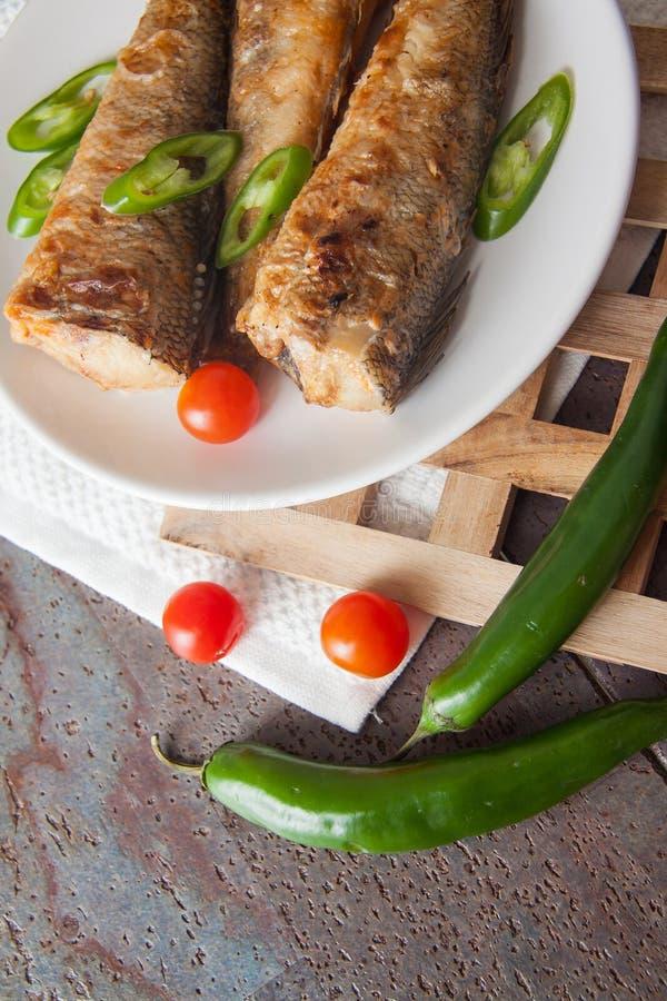 Geroosterde elft met tomaat royalty-vrije stock afbeeldingen