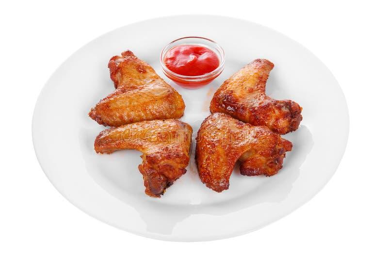 Geroosterde kippenvleugels met ketchupsaus royalty-vrije stock fotografie