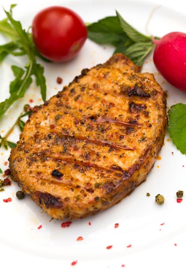 Geroosterde kotelet of schnitzel van varkensvlees stock afbeelding