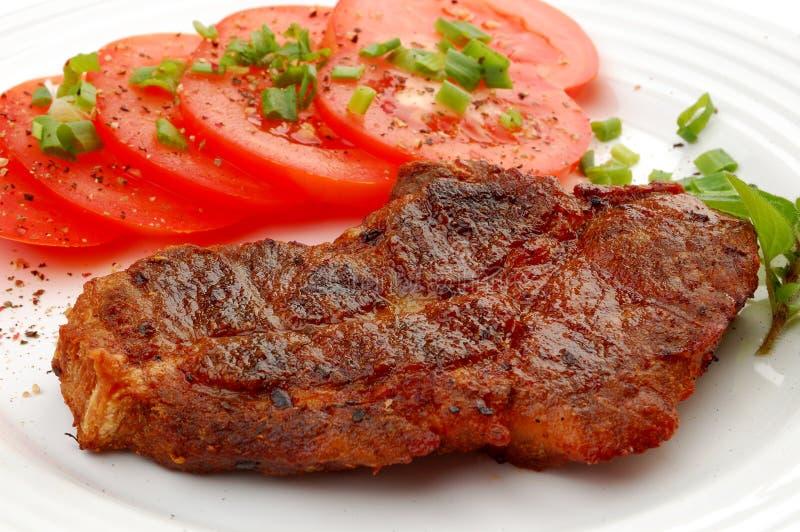 Geroosterde lapje vlees en groenten stock foto's