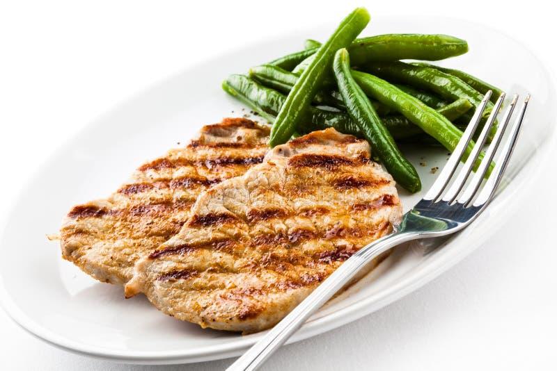 Geroosterde lapje vlees en slaboon stock afbeeldingen