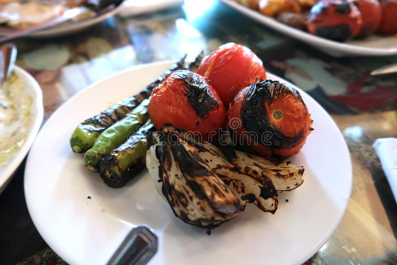 Geroosterde tomaat, ui en peper royalty-vrije stock foto's