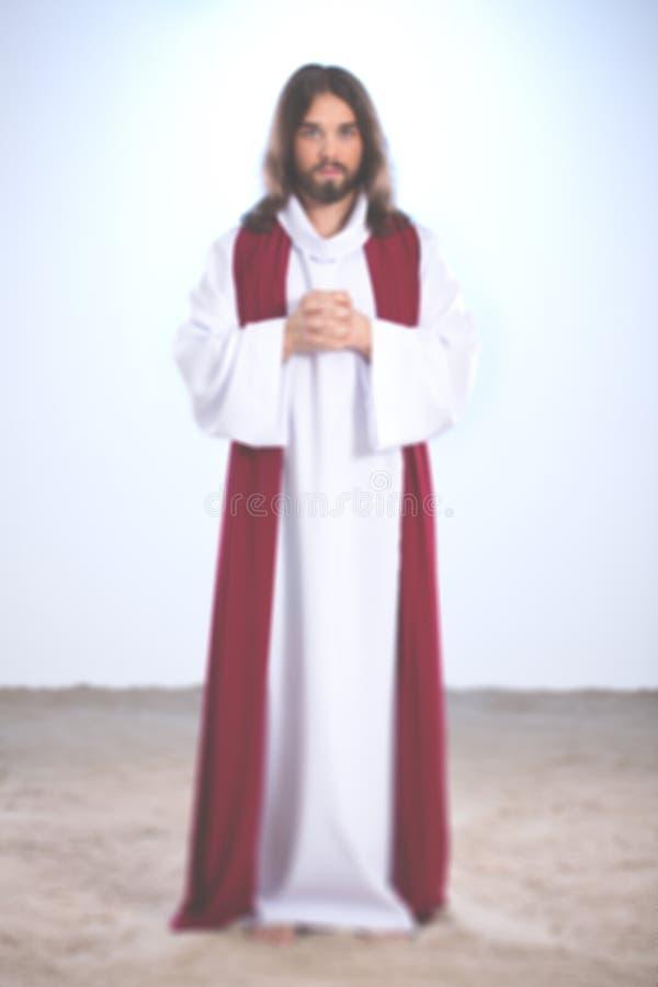 Gesù che dice una preghiera fotografie stock