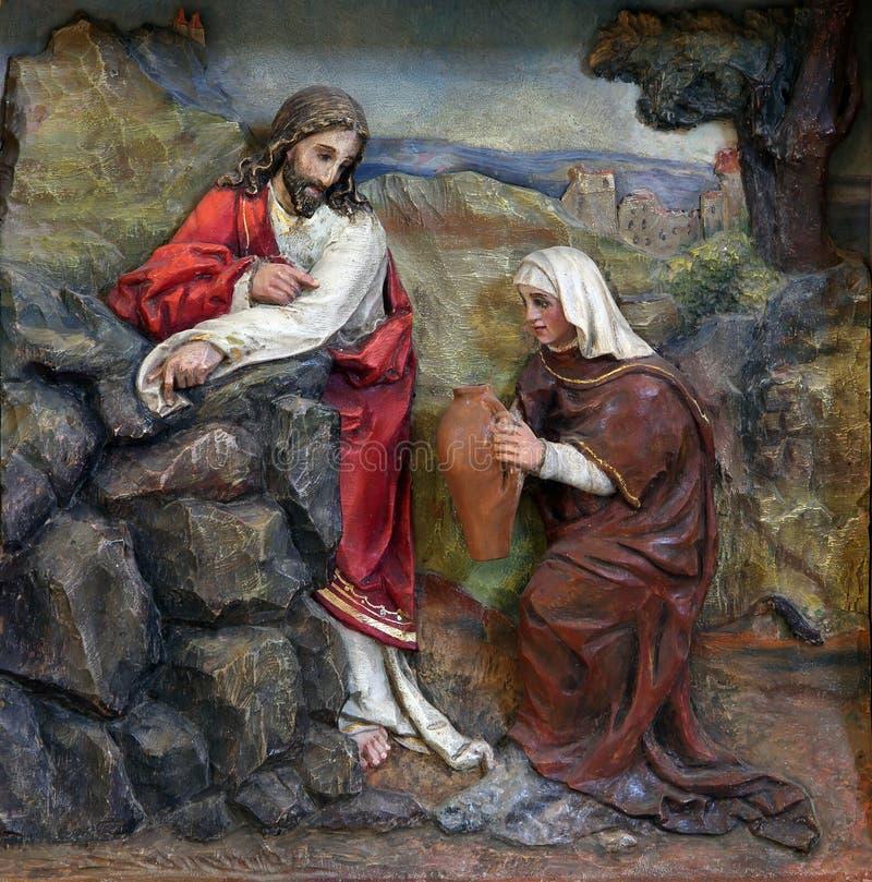 Gesù e la donna del samaritano fotografia stock