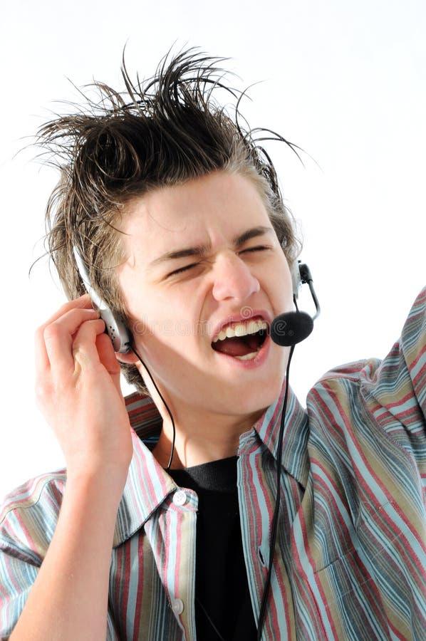 Gesang teennager lizenzfreie stockbilder
