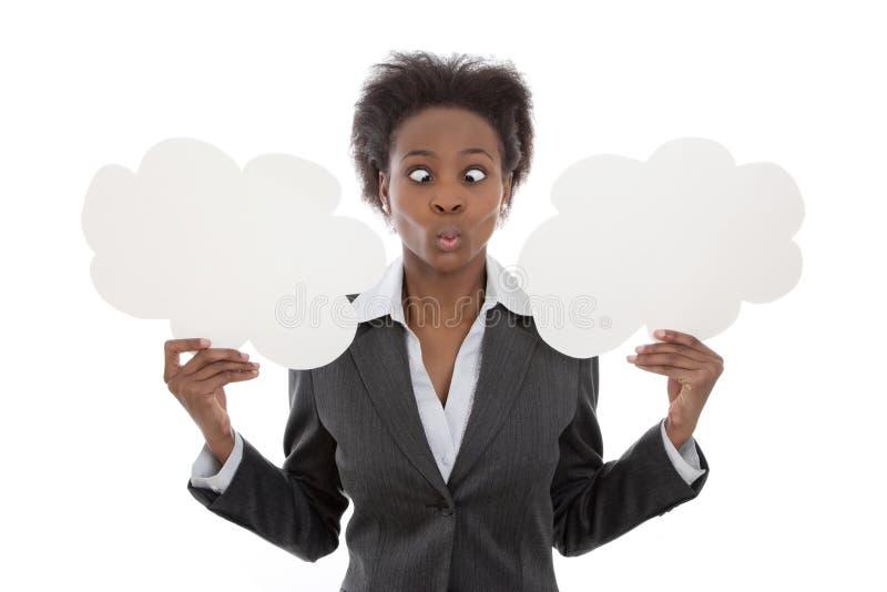 Geschäft; Afrikanerin gekreuzt gemustert, Wolkenzeichenisolat halten stockfotografie