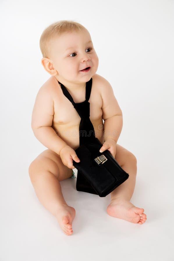Geschäft, ein kleines Kind in einer Bindung lizenzfreie stockfotografie