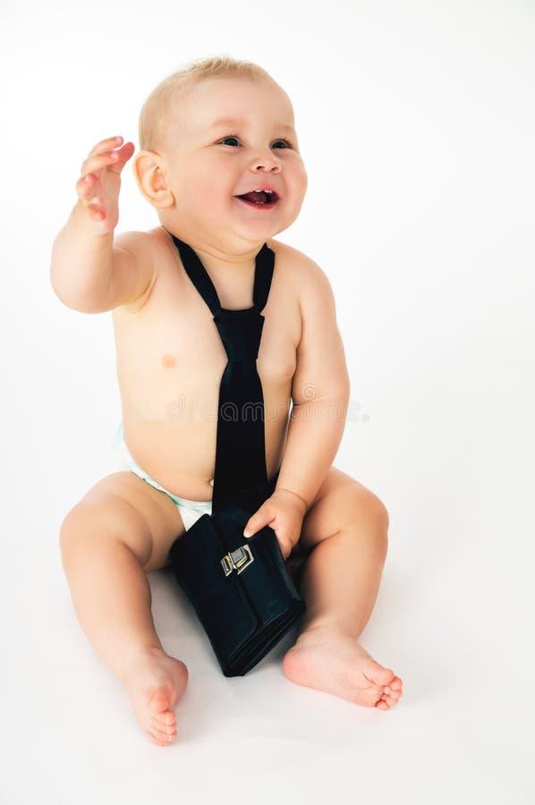 Geschäft, kleines Kind sitzt in einer Bindung lizenzfreies stockfoto