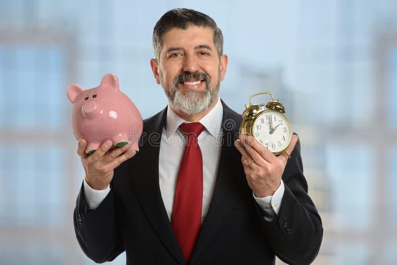 Geschäfts-Metapher von Zeit ist Geld stockfotos