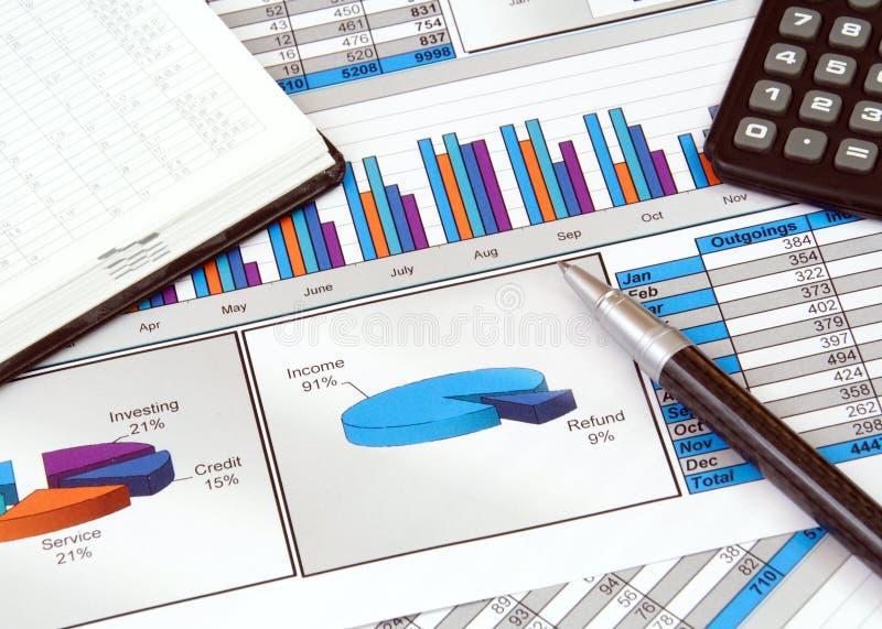 Geschäfts-noch Leben mit Diagrammen lizenzfreie stockbilder