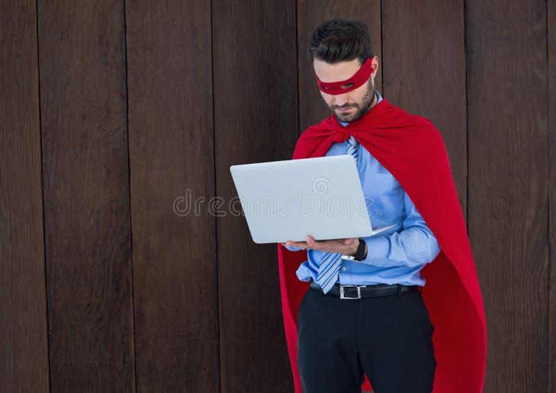 Geschäfts-Superheld gegen Holz stock abbildung