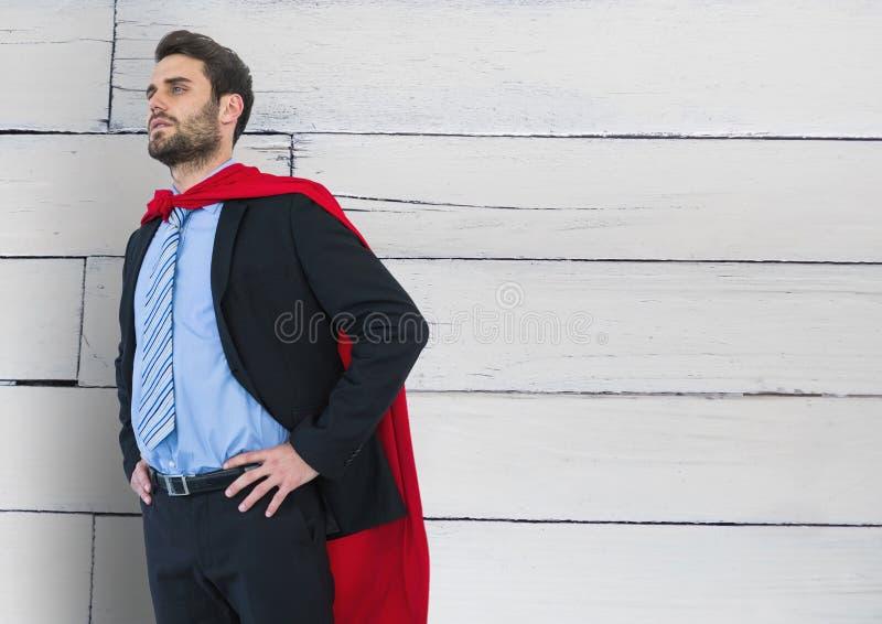 Geschäfts-Superheld gegen Holz lizenzfreie abbildung