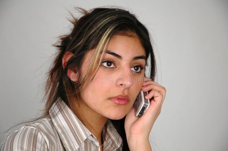 Geschäftsfrau auf dem phone-9 lizenzfreie stockbilder
