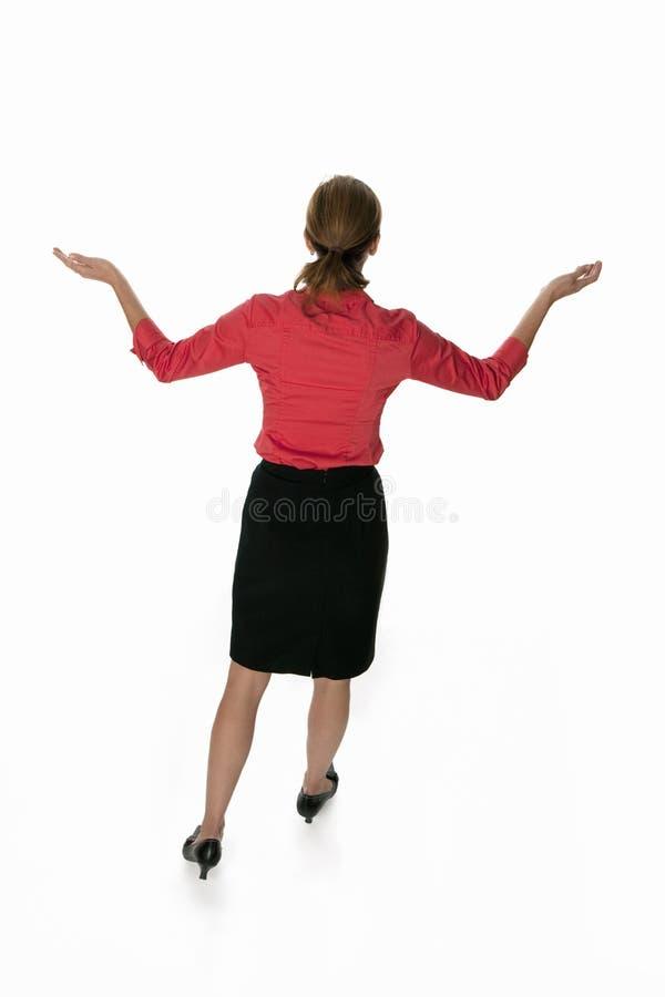 Geschäftsfrau backview mit Geste lizenzfreie stockfotos