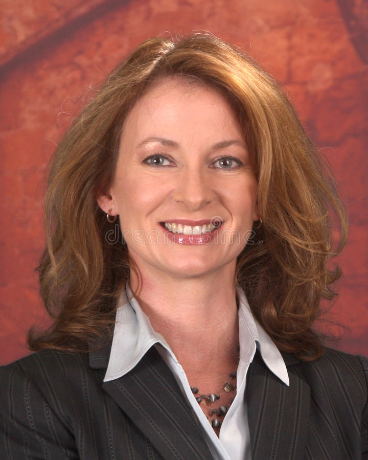 Geschäftsfrau in der Klage lizenzfreies stockbild
