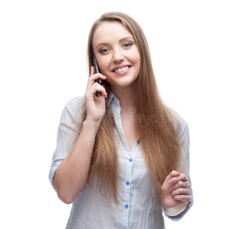 Geschäftsfrau, die auf Handy spricht lizenzfreie stockfotos