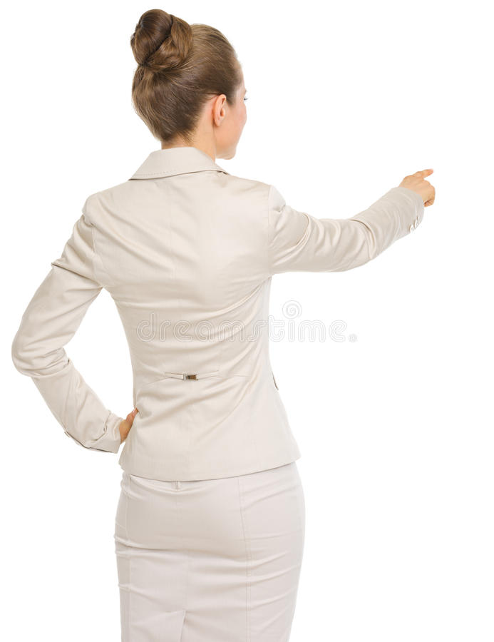 Geschäftsfrau, die auf Kopienraum zeigt. hintere Ansicht lizenzfreie stockfotografie